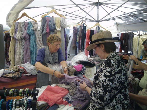 Shopping for scarves at the Roussillon market