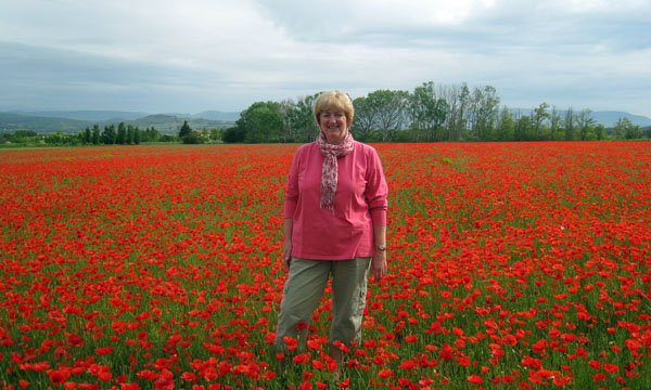 Happy in the poppies