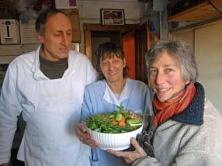 Eugenia poses with Renato, Heather and her vegetables