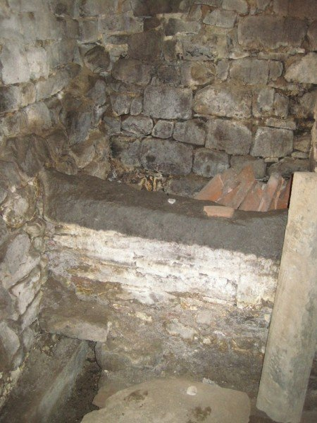 Basin where lime was slaked in house in Casabasciana