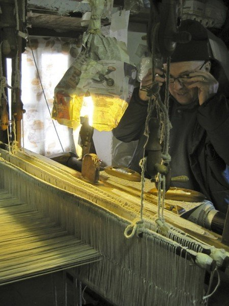 ...which he weaves on his century-old floor-loom into...