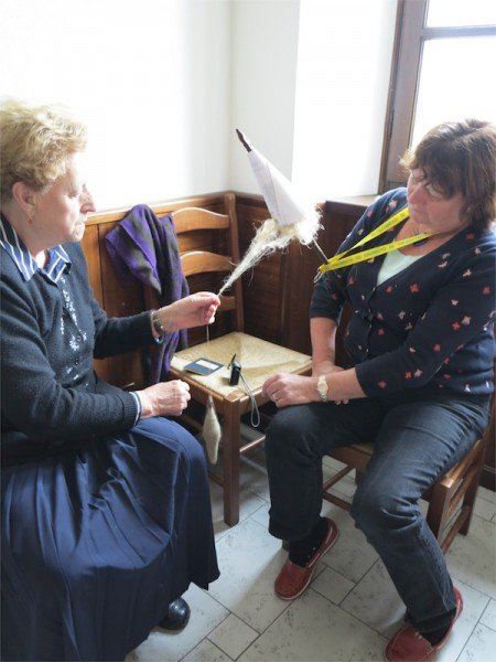 Now Teresa teaches my guests the art of spinning with a drop spindle.
