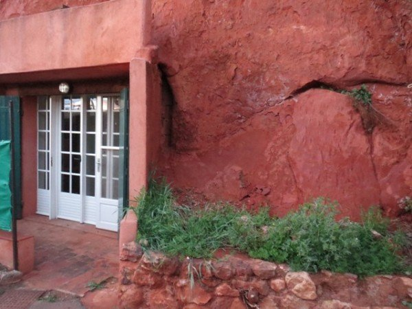 03301305 home carved into ochre cliff