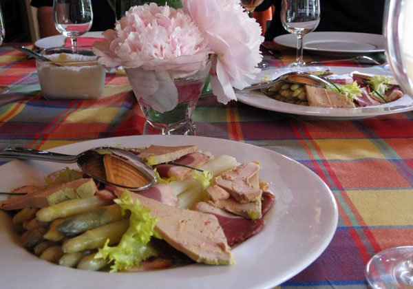 A shared  entrée of foie gras, smoked duck breast, and asparagus