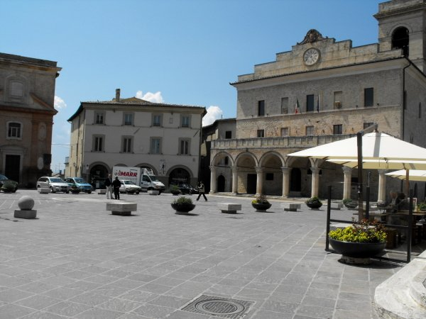 It has a bigger, more lively main piazza