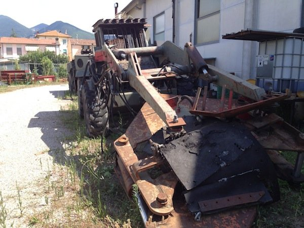 Tractor adapted to harvest pine cones