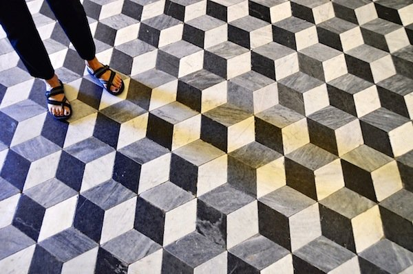 The floor of each chapel has a different design formed of marble tiles.