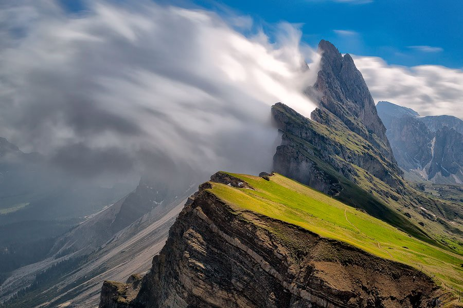 Dolomites, Italy. I was able to get this great effect of the moving clouds by using a 10 stop neutral density filter. It was 10 in the morning and quite bright out. With the use of this filter and a polarizer, I was able to slow my shutter speed down to 25 seconds.
