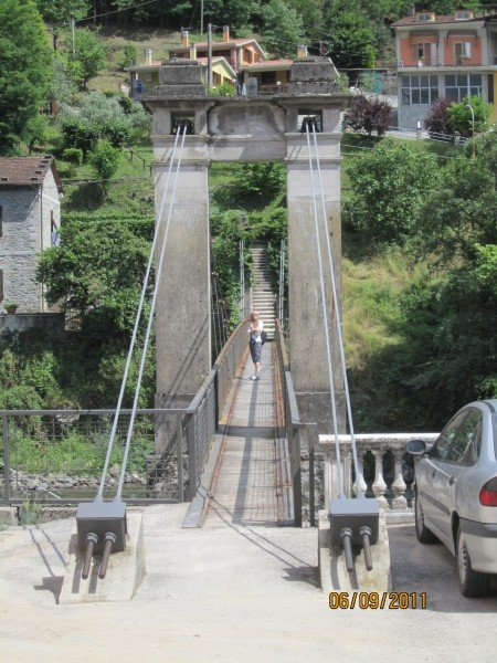 A pedestrian suspension bridge over the river.