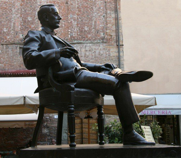 Puccini relaxing with a Tuscan cigar after a good cacciucco viareggiano