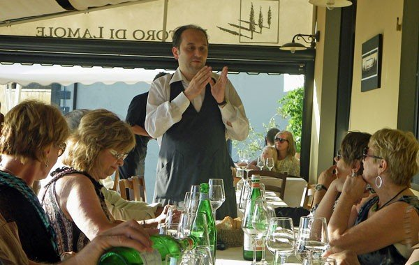 Filippo describes the night's menu to our Chianti Experience group