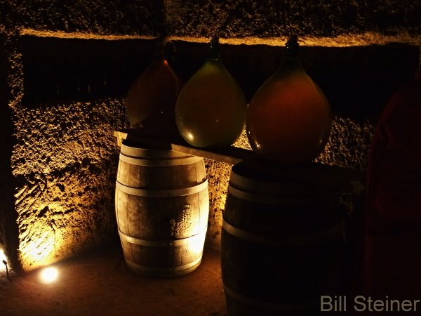 The wine is stored in demijohns
