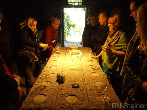 Tasting the wine in an Etruscan cave