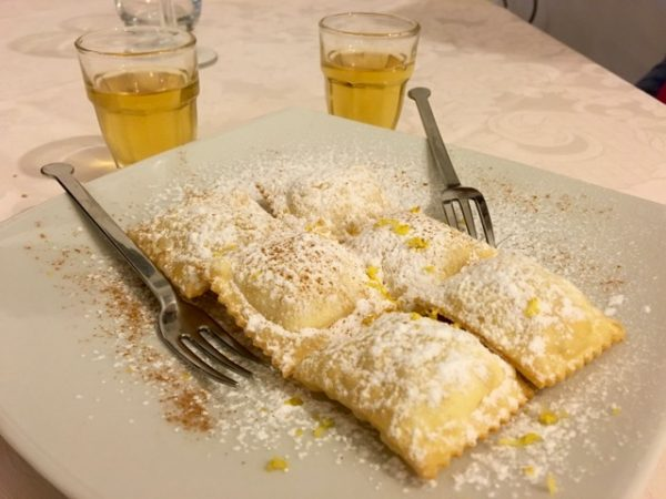 Luscious sweet ravioli accompanied by sweet wine, a sweet ending to a delicious Sardinian meal