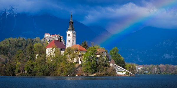 "Rainbow over the ""wedding church"" of St. Mary's in Bled, Slovenia"