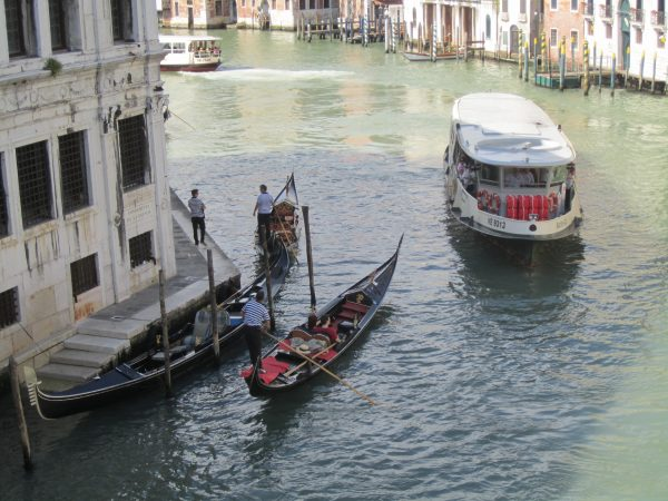 A vaporetto and gondolas along the Grand Canal.