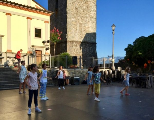Kids dance at Cascio