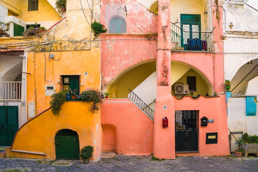 The colorful courtyard of Casale Vascello on Procida, Italy