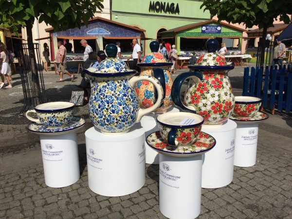 Oversized Polish Pottery pieces display at the festival.