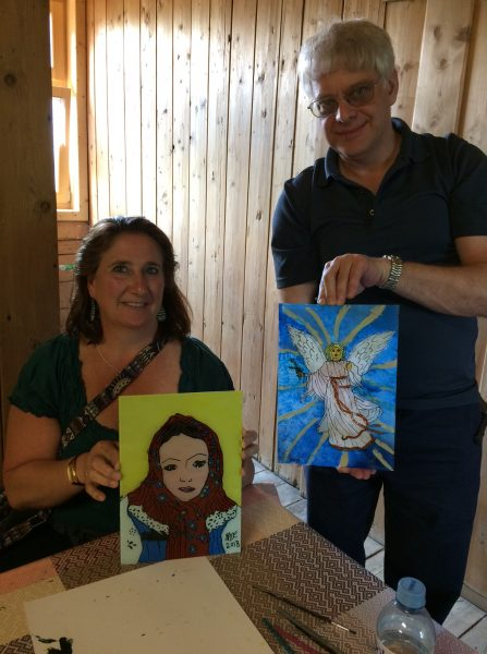"""Grace & Dean displaying their paintings - """"Cooking Your Way From Krakow to Zakopane"""" tour"""