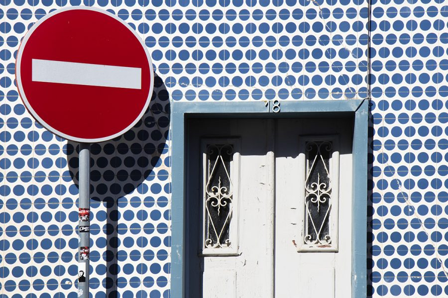 wall-with-blue-tiles-and-white-door-aveiro-portugal