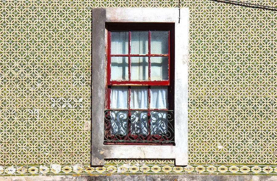 old-window-in-tiles-wall-aveiro-portugal