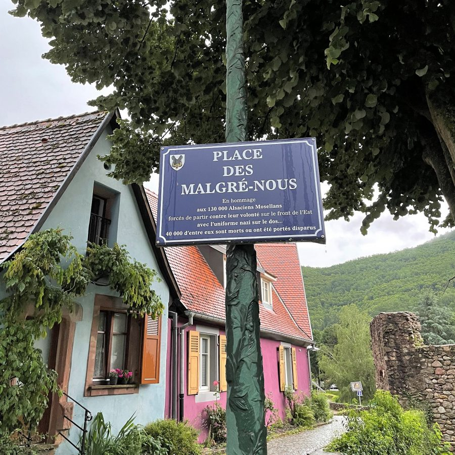 Sign denoting the Place des Malgre-Nous in Kaysersberg